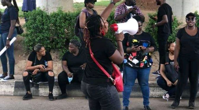 Woman forgets her baby at #EndSARs Abuja Protes